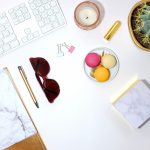 red-sunglasses-near-macaroons-desk décor
