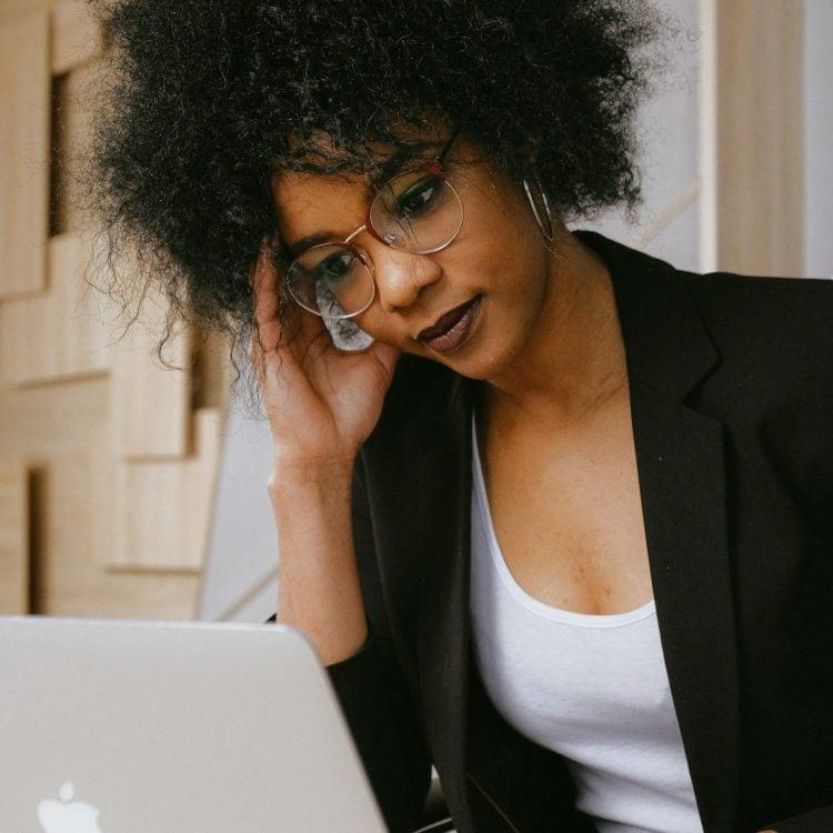 woman-in-black-blazer-wearing-eyeglasses-3727454